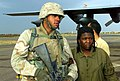 US Navy 030413-M-3558L-107 U.S. Marine Corps Lance Cpl. Curney Russell, assigned to the 3rd Light Armored Reconnaissance Battalion, provides a steady arm for rescued U.S. Prisoner of War (POW) Spc. Shoshana Johnson of the U.S.jpg