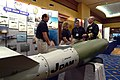 US Navy 030417-N-2383B-096 Adm. Vern Clark, Chief of Naval Operations (CNO) talks to exhibit representatives of the Joint Direct Attack Munition (JDAM) bomb, one of the many displays at the Navy League's 2003 Sea-Air-Space Expo.jpg