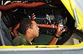 US Navy 030626-N-2468S-001 Aviation Electronics Technician 3rd Class Morris Graham inspects the wires in the cockpit of a MH-53E Sea Dragon helicopter.jpg