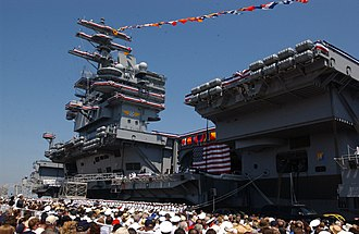 "Ship commissioning - Hundreds attend the commissioning ceremony for the nuclear-powered aircraft carrier USS Ronald Reagan. Nancy Reagan, wife of the ship's namesake, gave the ship's crew its traditional first order as an active unit of the Navy: ""Man the ship and bring her to life."""