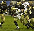 US Navy 031206-N-9693M-520 Navy quarterback Craig Candeto is wrapped up by an Army defender during the 104th Army Navy Game.jpg