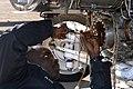 US Navy 040302-N-8770A-001 Aviation Machinist's Mate 3rd Class Pierre Pilacin completes maintenance on an engine oil gear box for an EA-6B Prowler.jpg