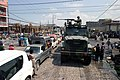 US Navy 040405-M-8172E-033 A 7-ton vehicle, part of a convoy carrying U.S. Marines assigned to 3-8 Kilo Company, makes its way through congested traffic and piles of debris in Port-Au Prince.jpg