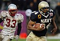 US Navy 041230-N-9693M-378 U.S. Naval Academy slot back Eric Roberts outpaces New Mexico linebacker Fola Fashola for yardage in the 4th quarter of play against the Lobos of New Mexico.jpg