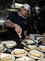 US Navy 050217-N-3390M-015 Quartermaster 3rd Class Derek Declue prepares lemon pie to be served aboard the guided missile frigate USS Rodney M. Davis (FFG 60).jpg