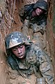 US Navy 050225-N-9712C-003 U. S. Marines low-crawl through muddy trenches during the endurance course at the Jungle Warfare Training Center on board Camp Gonslaves, Okinawa.jpg