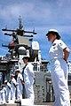 US Navy 050825-N-5914D-001 Sailors man the rails as the amphibious assault ship USS Boxer (LHD 4) pulls into Majuro, Marshall Islands, to conduct a community outreach program.jpg