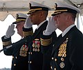 US Navy 051202-N-6639M-005 From left, Rear Adm. Garry Hall, Capt. Edward Barfield and Capt. Robert Bougher render honors during the National Anthem before the Commander Amphibious Squadron Eight change of command.jpg