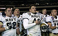 US Navy 051203-G-9409S-057 The U.S. Naval Academy Midshipmen team sing their Alma Mater following a 42-23 win over the Black Knights of Army, at the 106th playing of Army vs. Navy Football game.jpg
