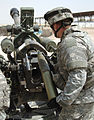 US Navy 060810-N-7590D-026 U.S. Army Pfc. Melvin Odell of the Archangels from 4th Battalion, 320th Field Artillery, 506th Regimental Combat Team, 101st Airborne Division loads a 105mm artillery round into his 105mm M119-A2 Ligh.jpg