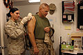 US Navy 061102-M-9578B-139 Assistant Division Commander, 1st Marine Division, Maj. Gen. Robert B. Neller, right, receives a flu shot.jpg
