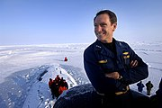 US Navy 070318-N-3642E-343 Commander, Submarine Force, Vice Adm. John Donnelly looks over the frozen Arctic Ocean from the bridge of attack submarine USS Alexandria (SSN 757).jpg