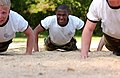 US Navy 070515-N-8395K-002 A midshipman fourth class tackles the Naval Academy obstacle course during Sea Trials.jpg