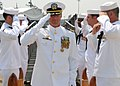 US Navy 070706-N-8655E-003 Cmdr. Scott Adams is piped ashore during the Los Angeles-class attack submarine USS Norfolk (SSN 714) change of command ceremony held on board Naval Station Norfolk.jpg