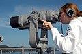 US Navy 070730-N-7029R-020 Seaman Rachael Phillips scans the horizon while USS Pearl Harbor (LSD 52) prepares to moor pierside during Partnership of the Americas (POA) 2007 deployment.jpg