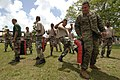 US Navy 070828-N-0989H-027 Marine Corps Staff Sgt. Oscar Cruz, assigned to a U.S. Marine Corps mobile training team, assists recruits of the Belize Defense Force on martial arts pad drills and unarmed manipulations during small.jpg
