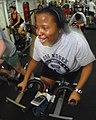 US Navy 080219-N-6936D-037 Cryptologic Technician 3rd Class Domonique Clarke exercises on a spin bike aboard the amphibious assault ship USS Essex (LHD 2).jpg