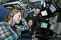 US Navy 081022-N-7441H-003 Sonar Technician 1st Class Billy Trowbridge points out several features of the control room to Elizabeth Godin and Elizabeth Palczynski.jpg
