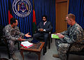 US Navy 081110-N-6483G-001 Public Affairs Officers from the recently established United States Forces Afghanistan coordinate with the Government of the Islamic Republic of Afghanistan Ministry of Interior spokesperson, Zemarai.jpg