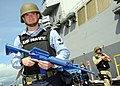 US Navy 090219-N-9758L-255 Electronics Technician 3rd Class Jarred Monju patrols the pier of Naval Station Pearl Harbor during an anti-terrorism force protection drill.jpg