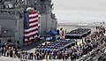 US Navy 090417-O-0000X-001 ailors assigned to Pre-Commissioning Unit (PCU) Makin Island (LHD 8) participate in the ceremony delivering the ship from Northrop Grumman Shipbuilding, Gulf Coast to the U.S. Navy.jpg