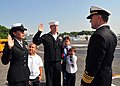US Navy 090428-N-6233C-045 Vice Adm. Bruce MacDonald, Judge Advocate General of the U.S. Navy, re-enlists Legalman 1st Class Shawn Sargent and Legalman 2nd Class Marcella Grant.jpg