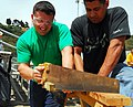 US Navy 090508-N-2183K-128 Builder 2nd Class Richard Falvo competes in a timed sawing contest during The Seabee Challenge competition at Naval Base Point Loma.jpg