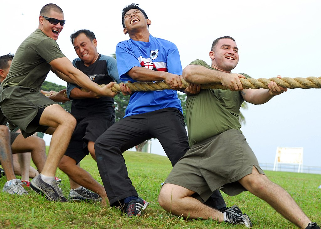US Navy 090807-N-5207L-345 ance Cpl. Steve Martinez, right, leads fellow U.S. Marines and Sailors from the Royal Brunei Navy in a tug-of-war during a Cooperation Afloat Readiness and Training (CARAT) Brunei 2009 sports day