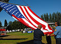 US Navy 090912-N-9860Y-008 Members of Navy Region Northwest Fire and Emergency Services raise the national ensign.jpg