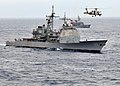 US Navy 091117-N-4010S-186 A Japan Maritime Self-Defense Force Mitsubishi SH-60J Sea Hawk helicopter flies over the guided-missile cruiser USS Cowpens (CG 63) during Annual Exercise (ANNUALEX 21G).jpg
