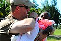 US Navy 100123-N-7508R-028 Chief Warrant Officer Jason Taggart prepares to medivac a Haitian child to a nearby treatment facility.jpg