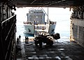 US Navy 100209-N-4971L-082 Army Landing Craft Utility (LCU) 2000 conducts a stern-gate marriage with the amphibious dock landing ship USS Fort McHenry (LSD 43) to take on pallets of relief supplies.jpg