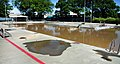 US Navy 100501-N-6046S-017 A previously empty swimming pool is left filled with flood water after heavy rains breeched nearby protective levees.jpg