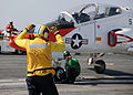 US Navy 100613-N-3885H-317 Sailors prepare a T-45A Goshawk for launch aboard USS George H.W. Bush (CVN 77).jpg