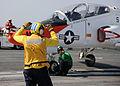 US Navy 100613-N-3885H-317 Sailors prepare a T-45A Goshawk for launch aboard USS George H.W. Bush (CVN 77).jpg