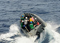 US Navy 100825-N-9301W-307 A rigid hull inflatable boat (RHIB) with search and rescue swimmers from the guided-missile frigate USS Klakring (FFG 42) is launched to recover a MK-46 recoverable exercise torpedo that was launched.jpg