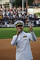 US Navy 110405-N-QM098-002 Cmdr. Abe Thompson sings God Bless America at PETCO Park during the seventh inning stretch at the San Diego Padres and S.jpg