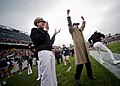 US Navy 111001-N-AC887-012 Secretary of the Navy (SECNAV) Ray Mabus cheers from the sideline as the U.S. Naval Academy Midshipmen recover an onside.jpg
