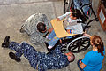 US Navy 120105-A-TF780-343 Cmdr. Garry Wright, right, mission commander of Southern Partnership Station 2012, adjusts a wheelchair at the Hope Have.jpg