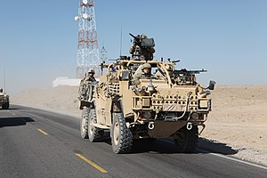Jackal (vehicle) - Coyote TSV with British, Australian and American personnel aboard in Afghanistan, 2011.