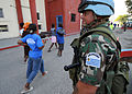 United Nations Peacekeepers from Uruguay provide security at a food distribution site outside the National Stadium in Port-au-Prince, Haiti 100216-N-HX866-002.jpg