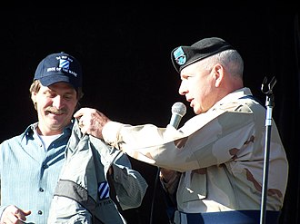 Jeff Foxworthy - Foxworthy accepting a new jacket from 3rd Infantry Division Commander Army Maj. Gen. William G. Webster for his support