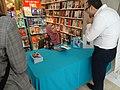 Uzma Jalaluddin signs her novel -c (48014850596).jpg
