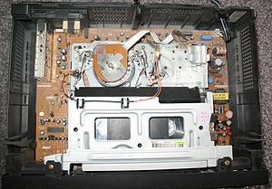 VHS - The interior of a modern VHS VCR showing the drum and tape.
