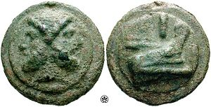 This is a coin with low resolution images on it: a two headed figure (Janus) and a ship's prow