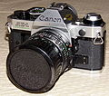 Vintage Canon AE-1 Program 35mm SLR Camera, One Of The Most Popular Cameras Of All Time, Made In Japan (13384530983).jpg