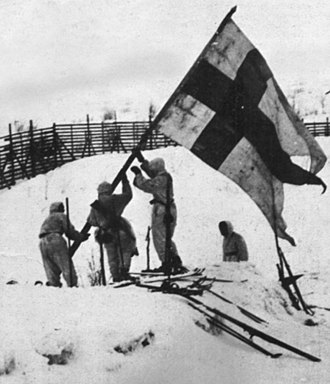 Enontekiö - Finnish soldiers hoist a flag at the Norwegian border after the last German soldiers were expelled.