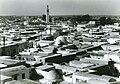 Vue sur El Jem et une mosquée.jpg