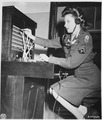 "WAC Cpl. Alma Bradley operates the switchboard at the ""Little White House,"" the residence of President Harry S.... - NARA - 198826.tif"