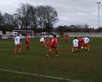 Midland Football Combination - Walsall Wood (red shirts) in action against Racing Club Warwick